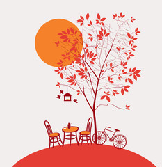 autumn landscape with a table and chairs under a tree