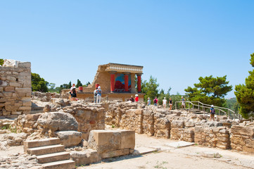 Tourists at the Knossos palace on the Crete island in Greece.
