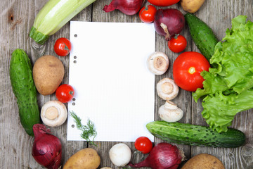Fresh vegetables and a paper for recipe