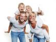 Leinwanddruck Bild - Parents giving piggyback ride to children