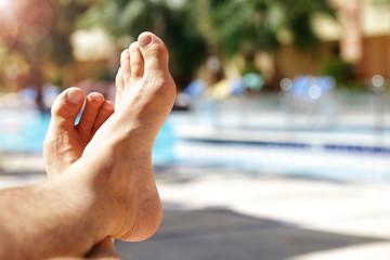 Sunbathing by swimming pool