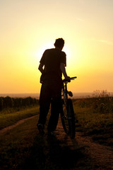 young man enjoying the sunset
