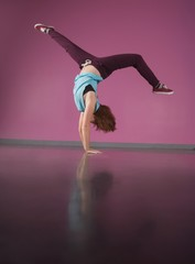 Pretty break dancer doing handstand