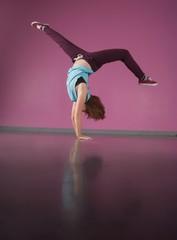 Pretty break dancer doing handstand