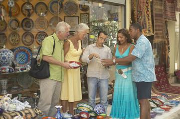 Senior couple shopping for pottery