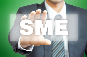 Businessman hand holding virtual screen with SME sign