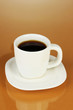 A cup of strong coffee on beige background