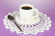 A cup of strong coffee on purple background