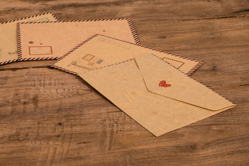 brown envelope on wooden background