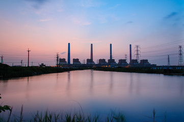 Silhouette of Power plant with sunset and reflection