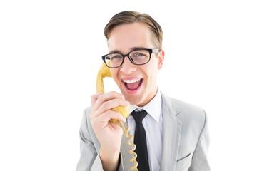 Geeky businessman talking on retro phone