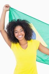 Pretty girl holding brazilian flag