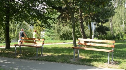 benches in the park - people in the background