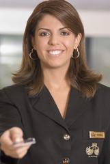 Hispanic woman handing back credit card