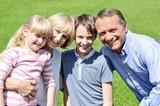 Lovable family enjoying sunny day outdoors poster
