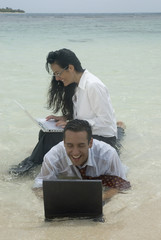 Hispanic businesspeople working in water