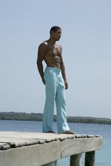 Hispanic man standing on dock