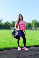 woman sport bag on stadium outdoors training