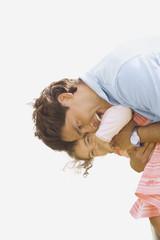 Hispanic father hugging daughter