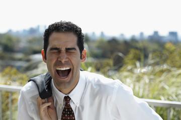 Hispanic businessman yelling
