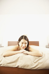 Asian woman laying on bed
