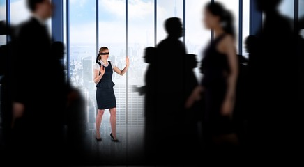 Composite image of business people walking in a blur