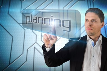 Businessman pointing to word planning
