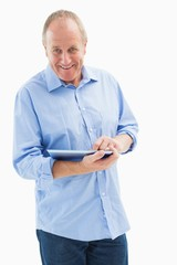 Happy mature man using his tablet pc