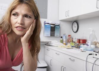 Hispanic woman at doctor's offic