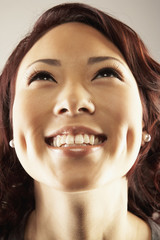 Asian woman looking up