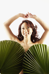 Nude Asian woman covered by larg