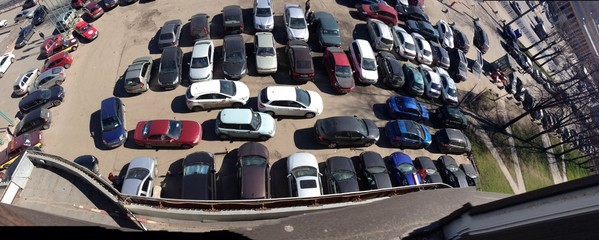 a lot of cars on parking