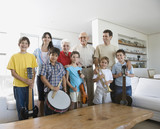 Multi-generational Hispanic family with musical instruments