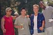 Multi-ethnic men with golf trophy