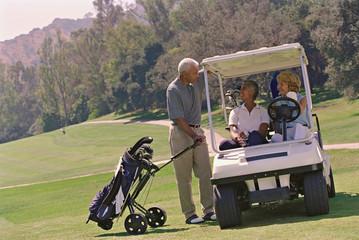 Multi-ethnic seniors on golf course
