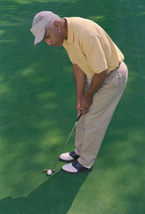 Senior African American man playing golf