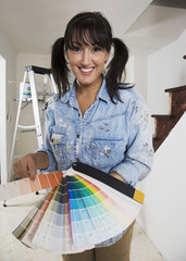 Middle Eastern woman holding paint swatches