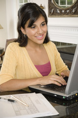 Mixed Race girl typing on laptop
