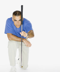 Middle Eastern man holding golf club