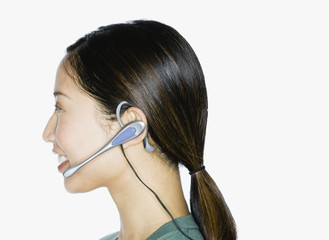 Asian woman wearing hands-free device