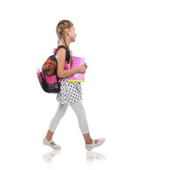 Happy little girl starts school, isolated