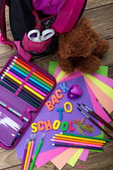 Many school stationery, school bags, teddy bears, a heap