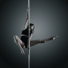pole dancer, young woman dancing on pylon, toned and noise added