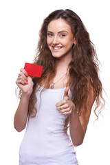 Playful woman showing blank credit card