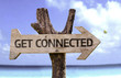 Get Connected wooden sign with a beach on background