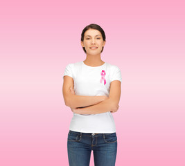 smiling woman with pink cancer awareness ribbon