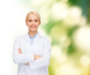 smiling female doctor over natural background