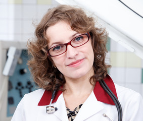 Pretty female doctor in glasses with stethoscope