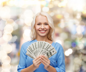 smiling young woman with us dollar money
