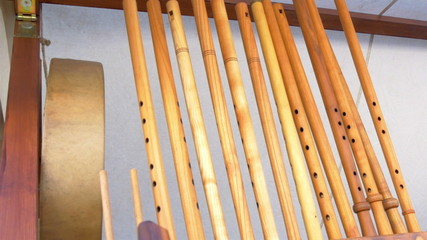 Lots of wooden flutes on display on the rack GH4 4K UHD